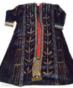 Very old Indigo dress with inlaid brass studs and embroidery from Yemen , wearable condition.