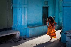 Photo Credit : Marji Marji Lang Light, Udaipur  Happy girl dancing in the light. Udaipur, Rajasthan, India.   National Geographic 'World in focus' 2010 contest winner travel.nationalgeographic.com/travel/2010-world-in-focus-...