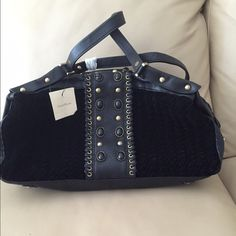 Authentic and real ColeHaan satchel purse Authentic and real ColeHaan purse. Large satchel, black velvet, village weave. Original price $450.00. Inside purse has cell phone pocket, large zipper pocket and another pocket. Has black jewels and gold studs on front and back. Cole Haan Bags Satchels