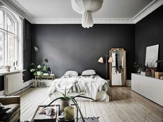 Spacious Studio Apartment With Dark Walls In Gothenburg - Gravity Home