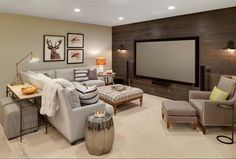 Love this basement look! Great wood treatment on tv wall. rRevere Pewter by Ben Moore HC-172. Ben Moore HC-172 Revere Pewter. The walls are painted in Revere Pewter from Ben Moore HC-172.