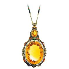 """Distinctive Art Deco Enamel Citrine Pearl Gold Necklace. Exciting 14kt. yellow gold faceted natural citrine necklace Egyptian inspired four color enamel in near perfect condition. The larger citrine weighs approx. 62.cts. surrounded by natural seed pearls. The enamel chain measures 24 1/2"""" circa 1920."""