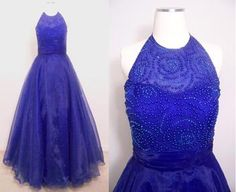 You are sure to look like royalty in this royal blue prom dress with beaded halter neckline and a-line skirt.