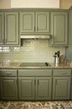 Green cabinets and counter. Not back splash