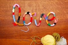 yarn-wrapped pipe cleaner letters