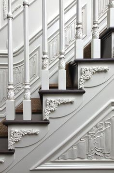 Dark wooden staircases can make a home look dreary. Painting them can often highlight the intricate details, make the house feel more modern, and brighten up the space.