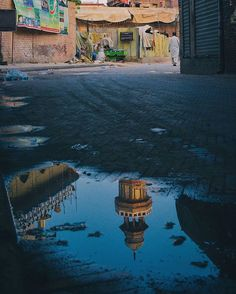 Minaret of Wazir Khan Mosque reflects in a puddle of water on the street in Lahore. Mosque, Fresco, The Dreamers, Construction, Architecture, Street, World, Instagram Posts, Water