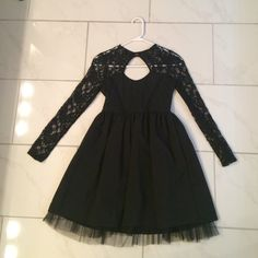 WISH black lace dress size M fits S never worn Black lace and a soft material. Bought from wish. Wish it was longer. Fit me tight on the shoulder but I have bigger shoulders. Would fit a XS or S. Never worn Lilbetter Dresses Long Sleeve