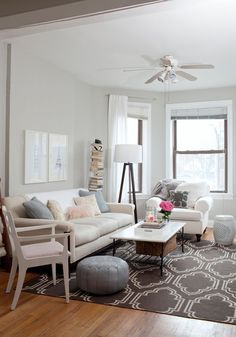 The neutral palette, pale accents and mix of modern patterns makes this contemporary space feel peaceful.