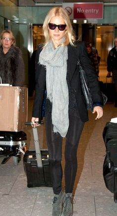 Gwyneth Paltrow arrives at Heathrow Airport on a flight from Los Angeles on Saturday (December 3) in London, England.