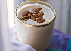 Easy Energy Almond Shake vegan, serves 2  2 cups almond milk or soymilk, vanilla flavor 2 large frozen bananas, ripe 2 Tbsp almond butter 1/2 cup ice 1/4 tsp cinnamon garnish: roasted almonds