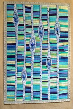 done in brown and green, this would be lovely.  Blue Tears Art Quilt Textile Wall Art by BozenaWojtaszek on Etsy, $250.00