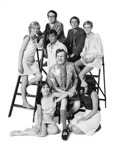 """The young """"in"""" group, 1967, by Lord Patrick Litchfield  Back row (left to right) Susannah York, Peter S Cook, Tom Courtenay, Twiggy, centre row (left to right) Joe Orton, Michael Fish, front row (left to right) Miranda Chiu, Lucy Fleming."""