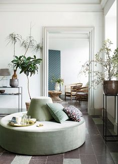 Add in some soft green hues with unique furniture pieces. See why sage green is the new neutral of 2018. #sage #green #neutral #paint #color #trends #sofa