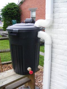 Cheapest DIY Rain Barrel (that works better than most) - Alex's Hobby Site.  LOVE THIS AND THE ENCLOSURE FOR IT