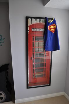 Superhero room how cute if you painted the closet door to look like a phone booth and hung capes on a hook inside the door?
