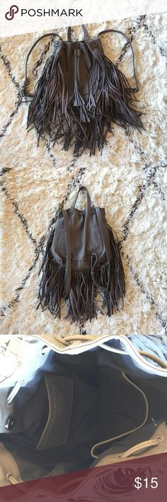 Forever 21 Fringe Backpack Used once! No scratches or imperfections. Mud gray color. Adjustable shoulder straps. Snap closure with cinch tie in front. Can fit quite a lot. Great for concerts and festivals 😉 Forever 21 Bags Backpacks