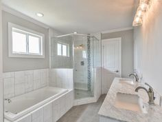 3531 Cove Ln Galveston, TX 77554: Photo Luxurious Master bathroom with a relaxing jetted tub, large tiled walk-in shower and marble double sink vanity. Notice the built-ins!
