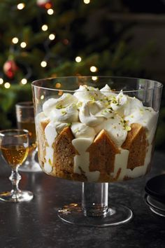 Waitrose recipe for orange and ginger syllabub trifle. Oranges are at their best at this time of year so why not make the most of them with this delicious dessert. Gourmet Food Gifts, Gourmet Recipes, Sweet Recipes, Dessert Recipes, Allrecipes Desserts, Xmas Food, Christmas Cooking, Christmas Desserts, Christmas Trifle