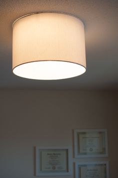Upgrade a ceiling light with a drum shade for under 15 for the embracing simplicity diy ceiling light fixture revamp using earth magnets and a barrel shade aloadofball Choice Image