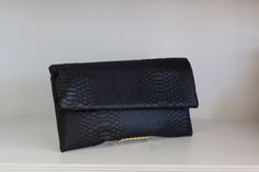 Roll top black clutch, with snakeskin texture.  Great for a night out!