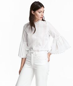 Check this out! Blouse in woven cotton fabric with hole embroidery. Small stand-up lace collar, opening at back of neck with button, and 3/4-length trumpet sleeves with scalloped trim and metal grommets at cuffs. Gently rounded hem. - Visit hm.com to see more.