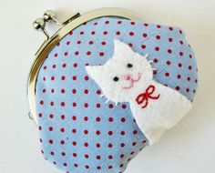 Coin purse - white cat red polka dots on blue. $33.00, via Etsy.