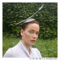 A #headpiece worn at my brothers wedding. Feather silver wire and pearls on metallic pleather base.