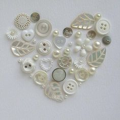 c Cute idea. Use old buttons to create a heart shape like this, top it off with a shadow box frame to finish the look, and you have homemade art! This would be cute in a star with colored buttons. Diy Buttons, Vintage Buttons, Buttons Ideas, Button Art, Button Crafts, Heart Button, Sewing Crafts, Diy Crafts, Beach Crafts