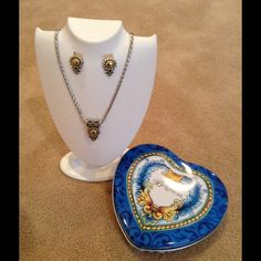 I have the necklace...just need the earrings! Brighton Moonglow reversible necklace and earrings Popular Moonglow set with original Brighton heart tin.  Gold tone and pearl necklace pendant, earrings are gold tone posts.  Adjustable 18 inch length. Very gently worn. Brighton Jewelry Necklaces