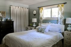 Lovely small master bedroom. Like the mismatched by complementary side tables with storage.