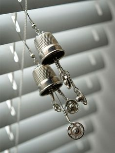 Thimble with snaps earrings. Could be a necklace also. Or for tee whimsical, a fairy wind chime.....