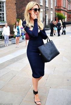 Love a form fitting dress...tone down the sexiness a bit by finding one that falls at or below your knees like this one.