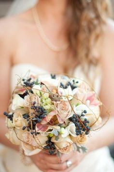 I like this cage around the bouquet. Those berries too!