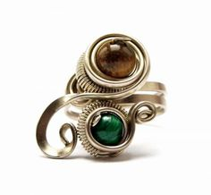 anillo de plata alemana con jade verde y ojo de tigre  plata alemana,alpaca,piedras semipreciosas alambrismo,wire wrapped