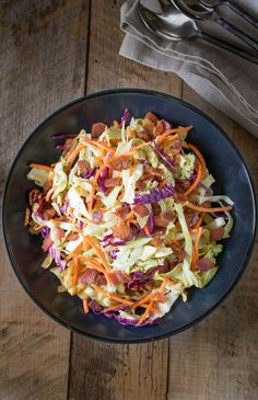 Warm bacon coleslaw is a quick and easy side dish that will perfectly accompany just about any meal. This is a warm and comforting recipe.