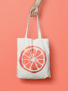 """Orange Fruit Tote Bag Canvas Kawaii  This bottle Tote bag is that universal product that everyone needs and uses. A book bag, a grocery bag, or just somewhere to throw in all of those little everyday items.  100% Bull Denim Woven Cotton construction Dimensions: 14 3/8"""" x 14"""" (36.5cm x 35.6cm) Dual handles Fabric weight 11.0 oz/yd² (373 g/m²) Superior screen printing results A cute, all-purpose natural cotton Orange Fruit tote bag."""