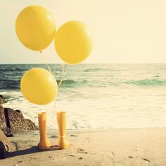Yellow balloon, yellow rain boots, and the ocean <3