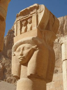 Standing proud and tall Goddess Hathor at Temple of Hatshepsut looks out over those who come to visit, welcoming.