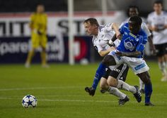 Photo from the Norwegian Tippeligaen match between rivals Rosenborg and Molde at Lerkendal stadium. Rosenborg won the match 3-1. In this photo Rosenborg midfielder Fredrik Winsnes (left) and Molde midfielder El Hadji Makthar
