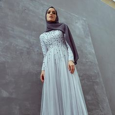 INAYAH | An evening wear gown featuring a jewelled and sequined bodice. Pair yours with your choice of Soft Crepe Hijab for a flattering finish. Thea Embellished Tulle Dress in Silver Charcoal Soft Crepe Hijab www.inayah.co
