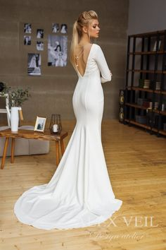 bfc716c63051 Wedding dress 'MARGOT' // Elegant and sexy mermaid wedding dress with open  back and long sleeves, minimalistic design and great fit