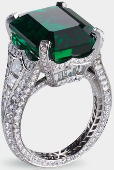 Fabergé Solyanka emerald ring. Centered by a 13.73 carat emerald and featuring 14 baguette diamonds and 251 round diamonds totaling 5.62 carats. Via Diamonds in the Library.