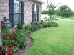 When designing a flower bed consider the lines and shapes of your house.  if your house has a lot of straight lines and boxy shapes (as most houses do), try using curved lines when designing your flower beds to incorporate more interest and variety.