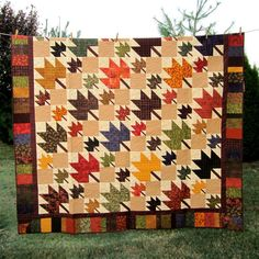 Fall Leaf Quilt - I love the 2 sizes of leaves. Great use for my browns, golds, purples, etc. Goal: complete by Fall 2013.