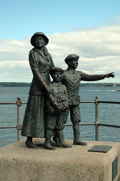 Statue of Annie Moore and her brothers pointing west towards America, found in Cobh Co. Cork.  Annie was the first immigrant to pass through Ellis Island.