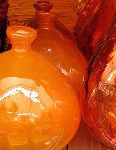 Rich hued orange glass vases.