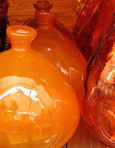 Rich hued orange glass vases.