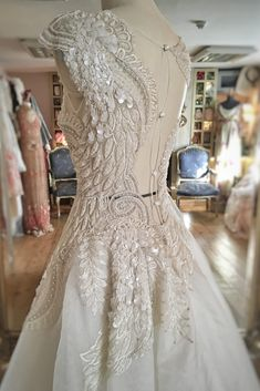 7f3e3fd13ad Beaded Feather Ballerina Wedding Dress with Swan Wing Detail