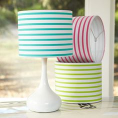This striped lamp shade might be cute somewhere in my house.  Still looking for that grey polka dot one, though.